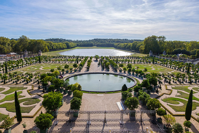Moring shot of the Versailles' garden in Paris. Wide angle shot with high dynamic range. The sky is reflecting on the water representing the beauty of France's horizonts